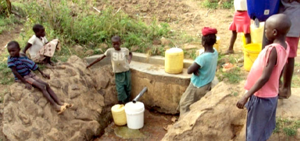 Community drawing water from a protected spring at Kabonyo, Suna-East Sub-County